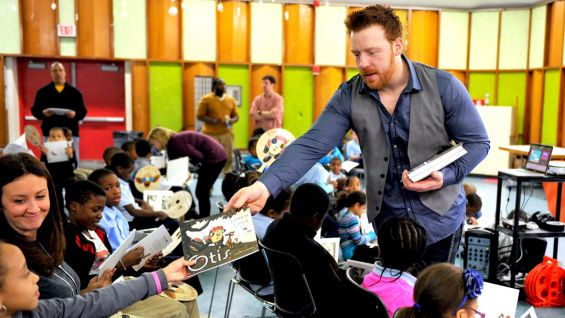 "Sheamus hands out copies of ""Otis"" to the Boston area kids."