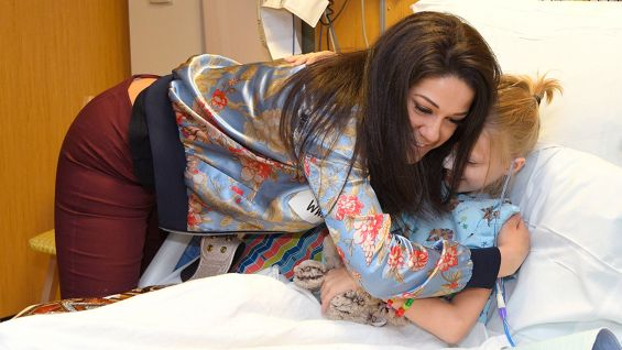 Raw Women's Champion Bayley has plenty of hugs for patients at the Florida Hosptial for Children.