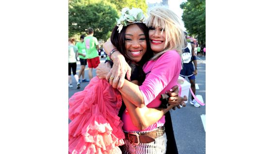 Designer Betsey Johnson gives Fox a big hug before the race gets underway.