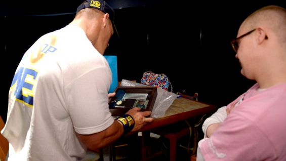 Patrick surprises Cena by giving him his Special Olympics gold medal in swimming!