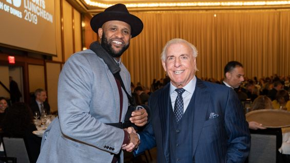 Ric Flair poses with recently retired New York Yankees pitcher CC Sabathia.