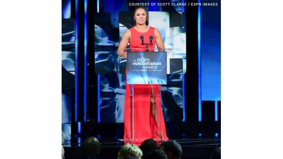 Ronda Rousey presents Stephanie with the Stuart Scott ENSPIRE Award.