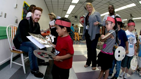 "Sheamus helps distribute ""Otis"" books to the kids."