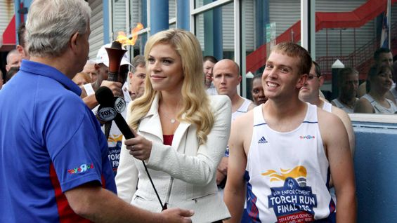 The Flame of Hope stops by Fox Sports in Manhattan.