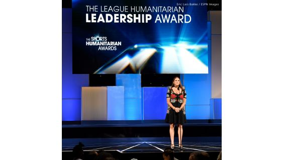 Stephanie presents The League Humanitarian Leadership Award, which WWE won in 2018.