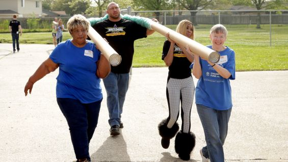 WWE and KaBOOM! volunteers work together to get the area ready for a brand new playground.