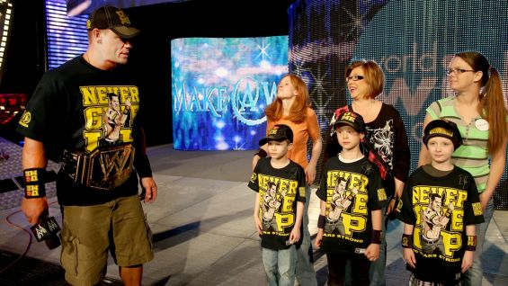 Cena takes the three boys out on stage before Raw to get a taste of WWE Superstardom.