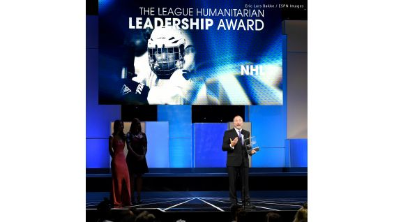 The League Humanitarian Leadership Award is presented to the NHL and is accepted by NHL Commissioner Gary Bettman.
