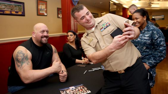 Big Show is more than happy to snap a selfie with a serviceman.