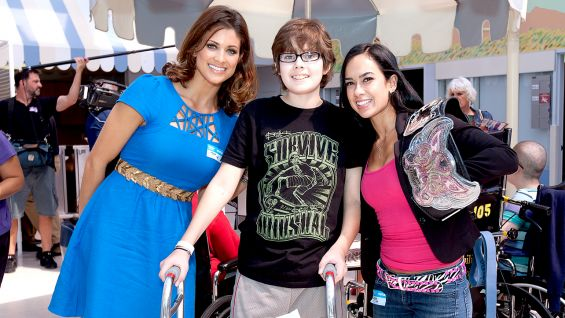 Eve Torres and Divas Champion AJ Lee meet one of the teens at Children's Hospital Los Angeles.