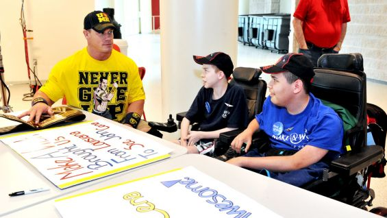 The WWE Champion checks out the boys' posters before Raw in Green Bay, Wisc.