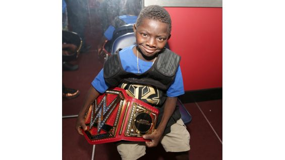 Jarrius proudly wears the gear of his favorite Superstar: Roman Reigns.