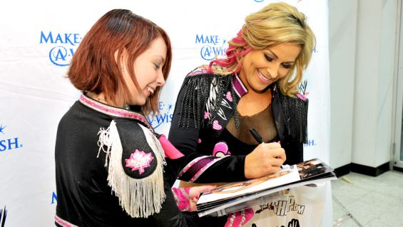 The third-generation Diva signs autographs for one of her biggest fans before Raw in Baltimore.