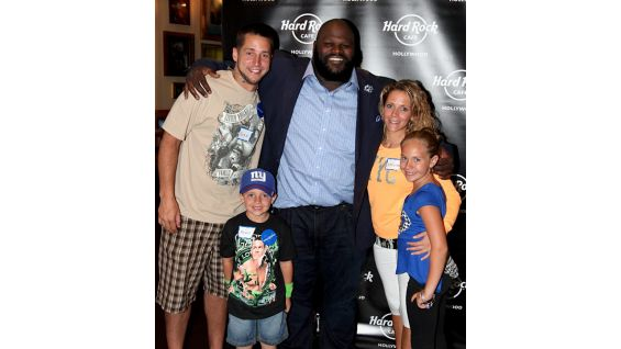 Ryan and his family pose with The World's Strongest Man.
