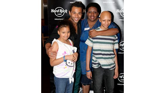 "Georgia and her family take a photo with ""High School Musical"" actor Corbin Bleu."