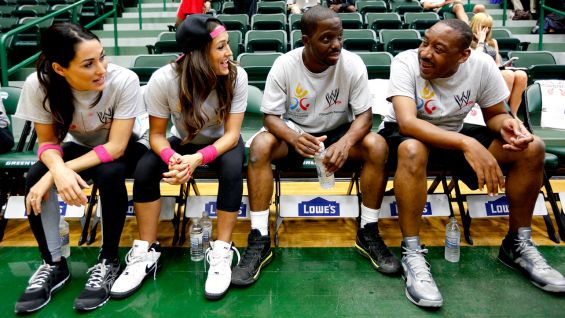 The Bellas chat with their players.
