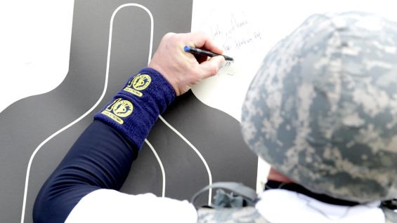 Cena leaves an autograph for the U.S. Troops who trained him.