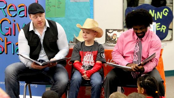 "Sheamus and NXT's Xavier Woods read ""Otis"" to Lex's second grade class."