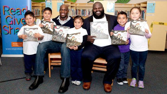 Titus O'Neil joins Mark Henry and students at a Reading Celebration in Oakland, Calif.