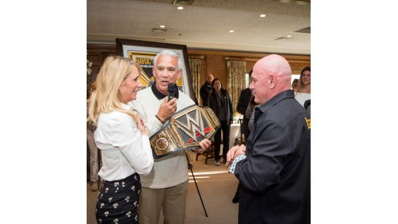 WWE Hall of Famer Ricky Steamboat presents the Citrone's with a WWE Championship. Several WWE prizes were up for grabs during the live tournament auction and silent auction, including an Ultimate SummerSlam Weekend.