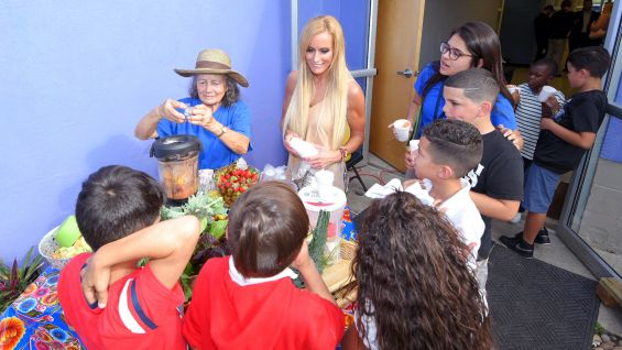 Dana Warrior helps prepare healthy snacks and drinks for the kids.