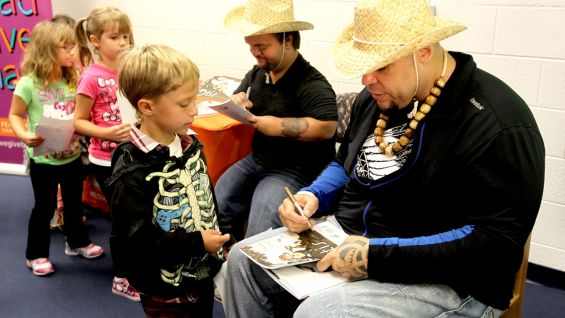 The Superstars sign autographs for the kids.