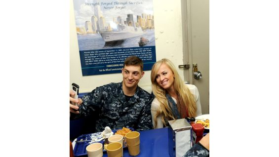 Summer Rae is happy to snap a selfie with a sailor serving on the USS New York.