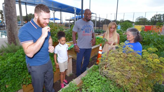 Sami Zayn and Titus O'Neil examine the contents of the garden.