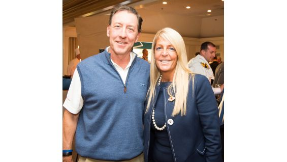 Michelle D. Wilson, WWE's Chief Revenue & Marketing Officer, takes a picture with George Bodenheimer, V Foundational Board Member and former President of ESPN.