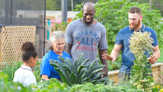 Titus O'Neil and Sami Zayn learn about how the staff and kids tend to the garden.