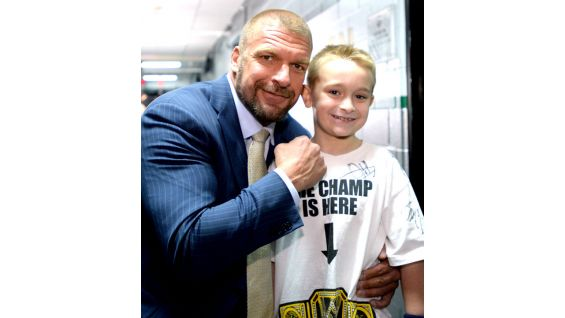 He also meets WWE COO Triple H!