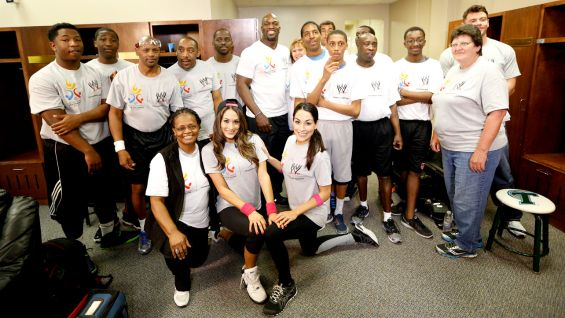 WWE Superstars and Divas take part in a Special Olympics Unified basketball game during WrestleMania Week in New Orleans.