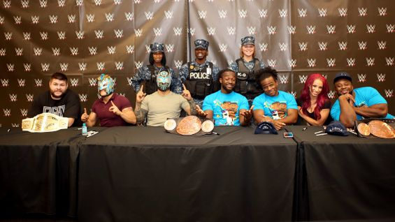 Kevin Owens, The New Day, The Lucha Dragons and Sasha Banks meet members of the U.S. Navy's K-9 unit.