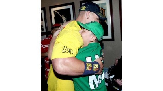 John Cena hugs a family member of a Wish kid.