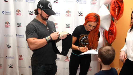 Styles and Becky sign autographs for their new friends.