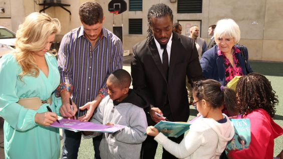 After receiving their books, the students went outside and each book was signed by the WWE Superstars.