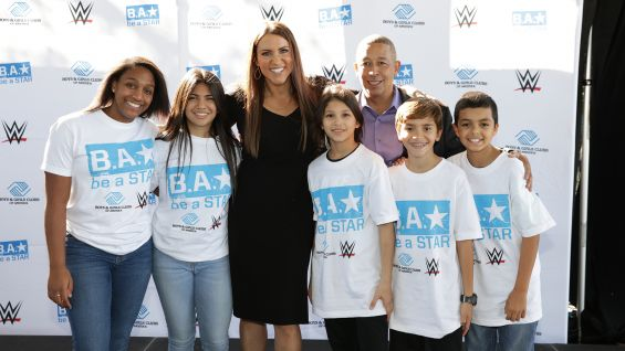 Chief Brand Officer Stephanie McMahon and Boys & Girls Clubs of America Vice President of Marketing Frank Sanchez meet children at the Miami-Dade Hank Kline Club in Miami.