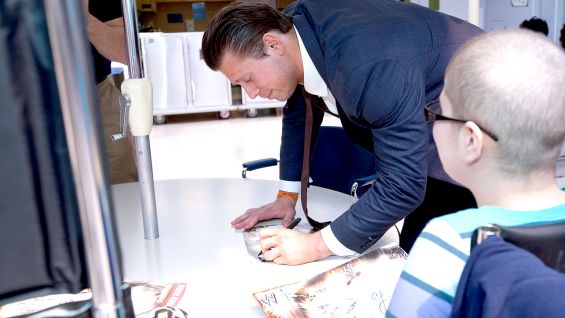 The Miz signs autographs for many of the children and teens at the hospital.