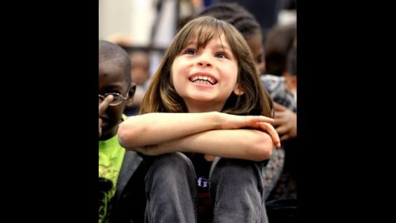 """The second graders listen as the Superstars read """"Stand Tall, Molly Lou Melon."""""""