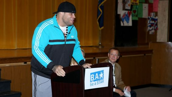 Brodus Clay always receives a warm welcome from students.