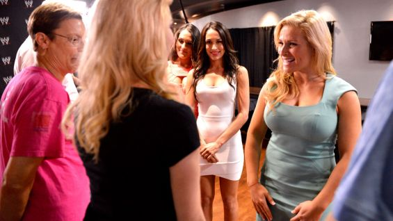 Natalya and The Bella Twins talk to the guests from Susan G. Komen for the Cure.