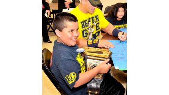 Getting to hold the WWE Championship is a thrill for the youngster.