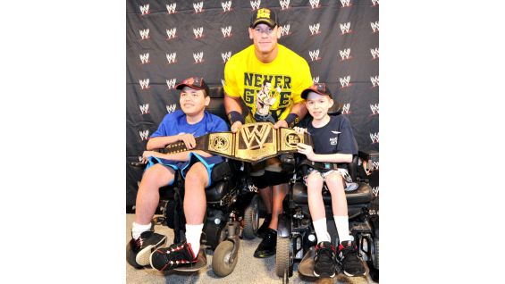 Cena poses with David and Parker, right, who is 10 years old and also from Make-A-Wish.