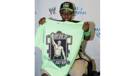 Khaleb shows off his new Cena T-shirt.