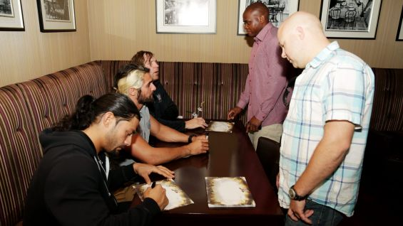 The Shield signs autographs for the U.S. Troops.