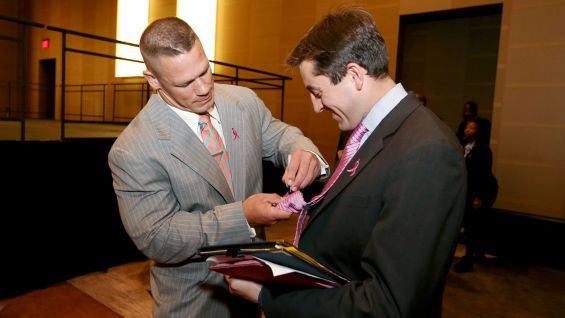 Cena signs a few autographs after the event, which was held June 21 at the Omni Dallas Hotel.