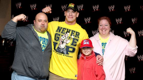 Cena poses with Autumn and her family.
