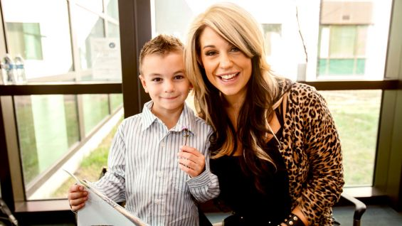 The Divas Champion visits with a young family member of a patient at the Medical Center.