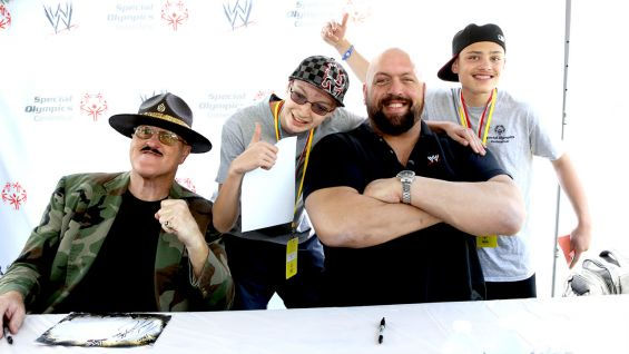 WWE Hall of Famer Sgt. Slaughter and Big Show meet members of the WWE Universe at the 2013 Special Olympics Connecticut Summer Games.