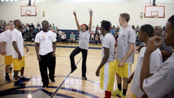 Kofi and Alicia pump up their teams before the big game.